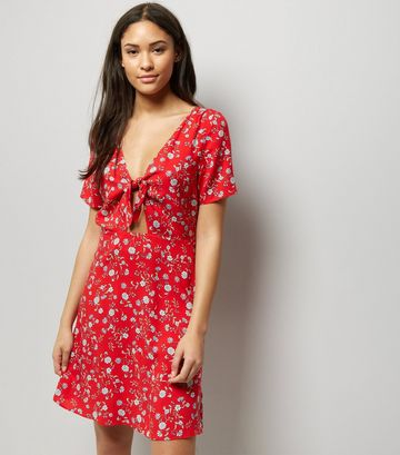http://www.newlook.com/uk/womens/clothing/dresses/red-floral-print-tie-front-skater-dress-/p/520450169?comp=Browse
