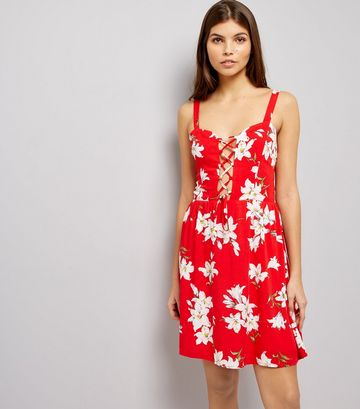 http://www.newlook.com/uk/womens/clothing/dresses/parisian-red-floral-print-lattice-front-dress/p/538291369?comp=Browse