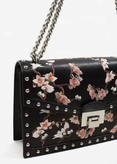https://shop.mango.com/be/femme/sacs-portes-croises/blouse-broderie-florale_13035023.html?c=99&n=1&s=search